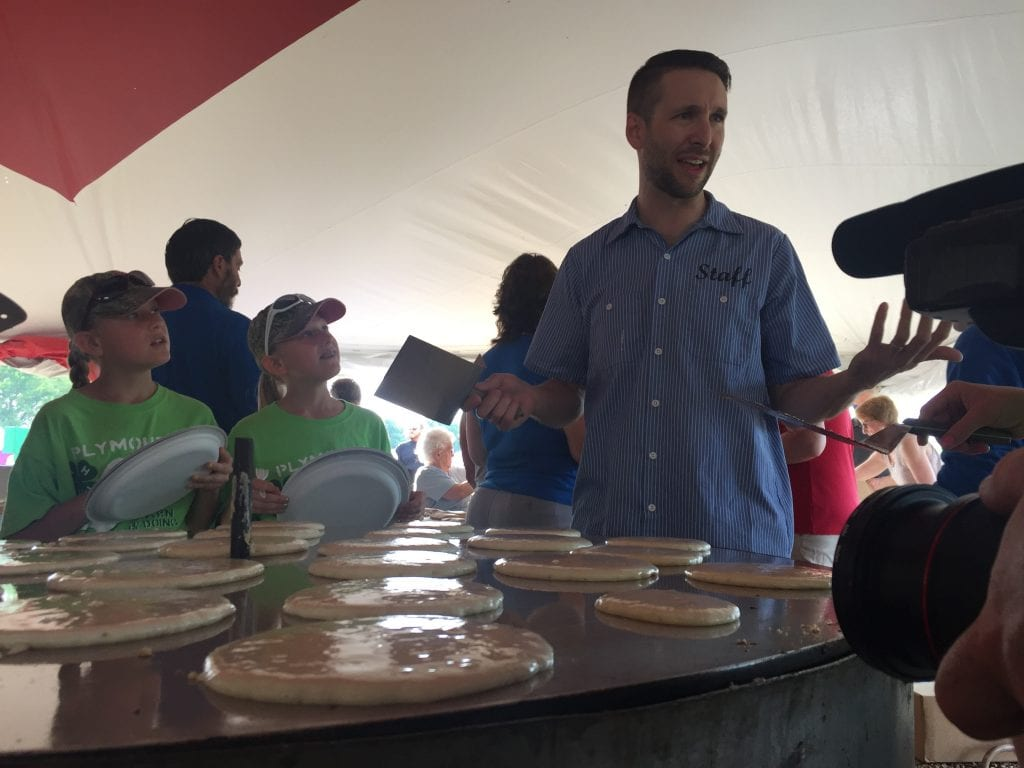 Collin gets ready to flip some pancakes at the Rock County Dairy Breakfast!