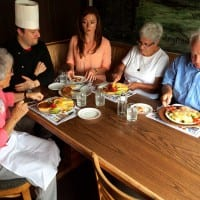Host Mariah Haberman dines with some swiss immigrants at the New Glarus Hotel in New Glarus, WI.