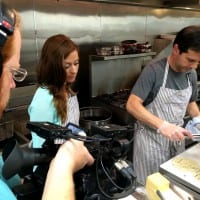 At La Merenda Mariah Haberman helps chef Peter Sandroni make mushroom tacos with Mononita Mexican-style cheese.