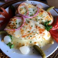 A traditional Swiss dish offered at the New Glarus Hotel; Raclette is made with an alpine-style cheese that's melted over a peeled baked potato.