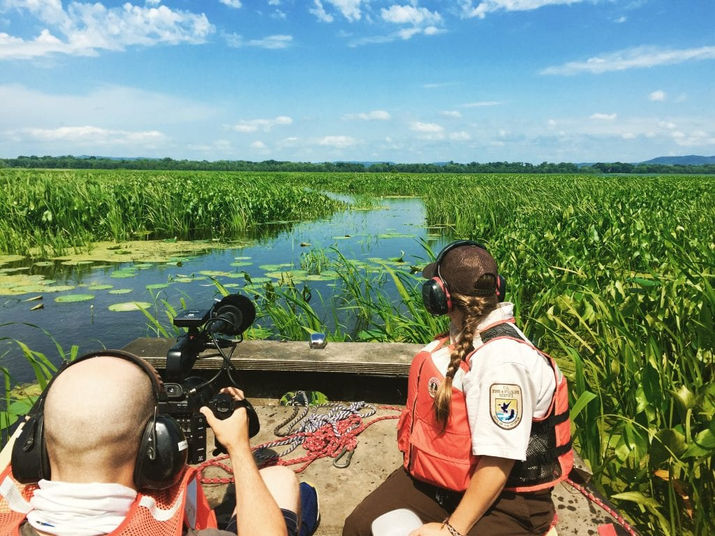 The crew films aboard an airboat in the La Crosse area.